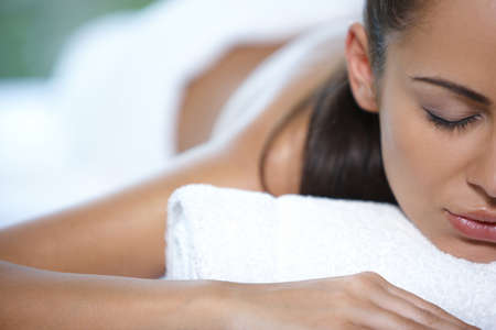 Beautiful woman is resting on spa bedの写真素材