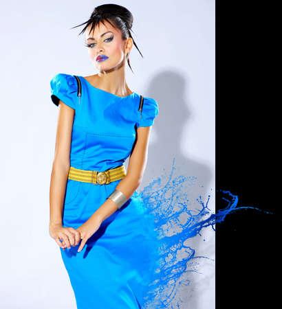 Photo for Beautiful female fashion model with paint splash - Royalty Free Image