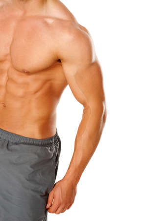 Photo pour A young man's chest and abs on white background - image libre de droit