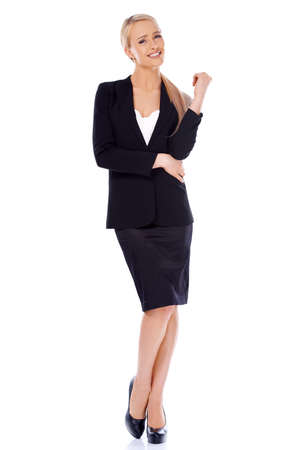Full body shot of blond smiling businesswoman standing isolated on whiteの写真素材