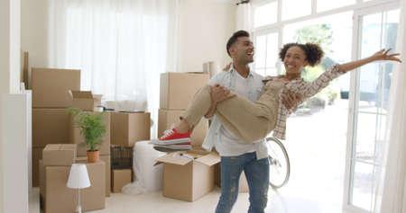 Foto de Ecstatic young couple celebrating their new home - Imagen libre de derechos