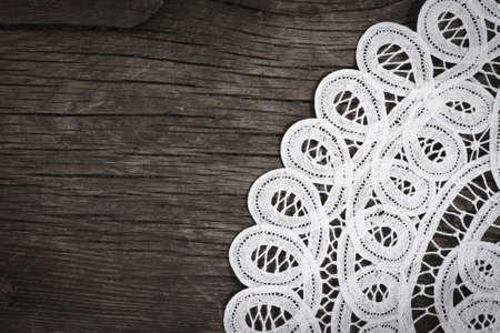 Photo pour White lace on the wooden background - image libre de droit