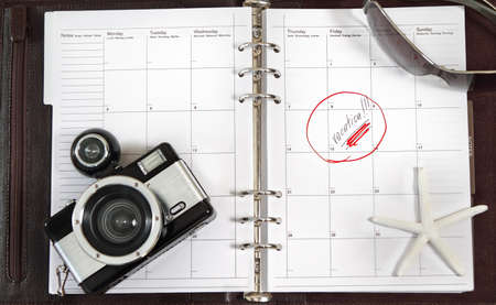 Notebook of the business person waiting for vacation