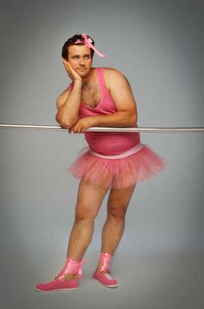 Crazy ballerina. Man wearing ballerina suit in pink color