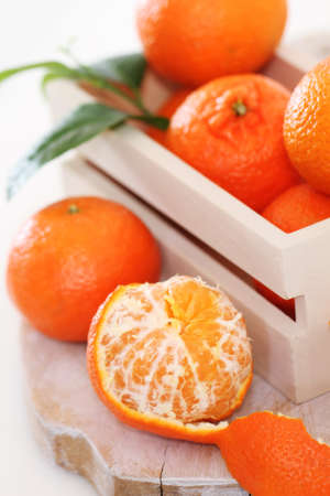 Fresh citrus fruits in the box on a wooden table
