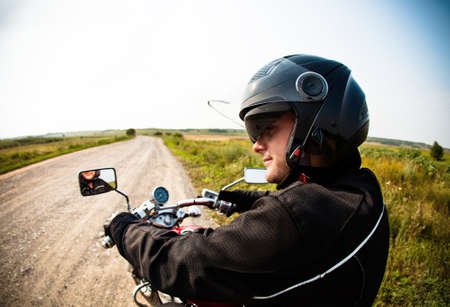 Photo for Biker on the country road against the sky - Royalty Free Image