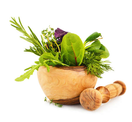 Photo pour Mortar with fresh herbs isolated on white background - image libre de droit