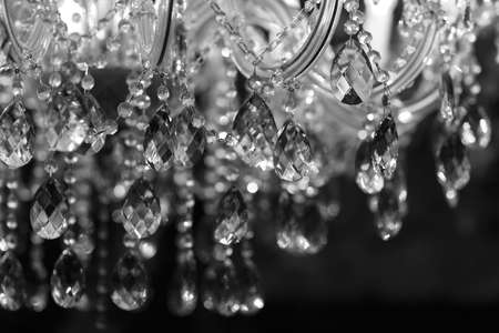 Chrystal chandelier close-up. Glamour black and white background with copy space