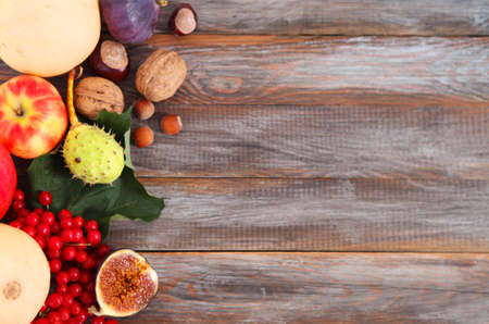 Autumn still life over wooden background