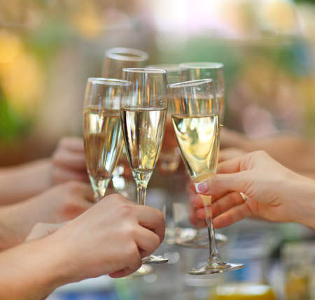 Photo pour Celebration. People holding glasses of champagne making a toast - image libre de droit