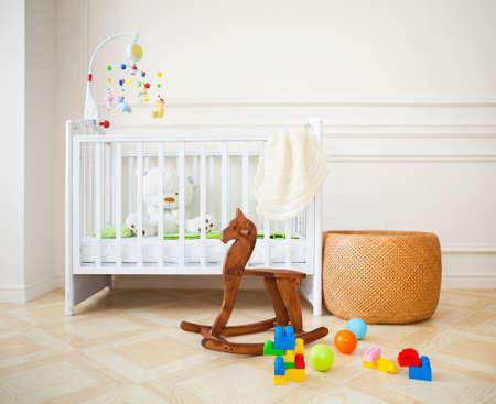 Photo pour Empty nursery room with basket, toys and wooden horse - image libre de droit