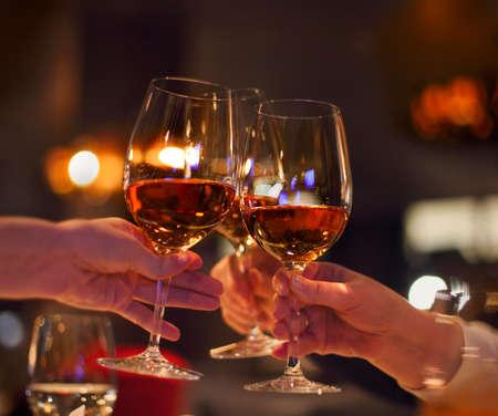 Photo pour Toast in restaurant with full glasses of rose wine. Celebration concept - image libre de droit