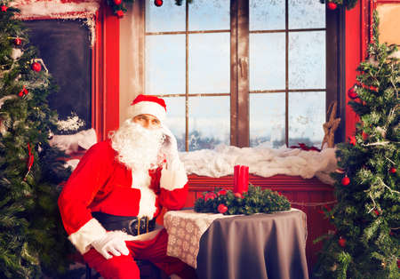 Portrait of a Santa Claus using a smart phone