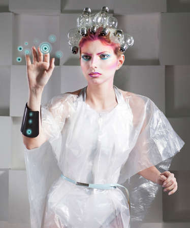 Attractive blonde woman touching the button in virtual future interface