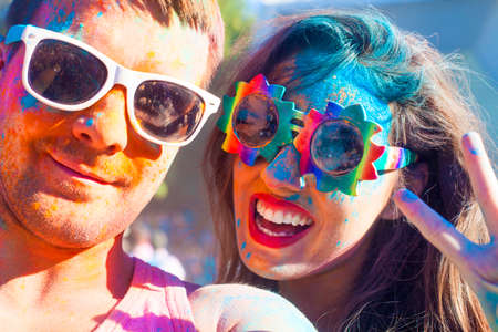 Foto de Portrait of happy couple in love on holi color festival - Imagen libre de derechos