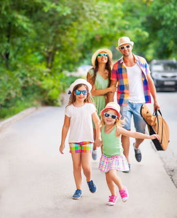 Photo pour Happy young family walking with guitar spending carefree time together. Travel and holiday concept - image libre de droit
