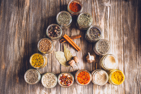 Various Colorful Kinds Of Spices On Rustic Wooden Table Top