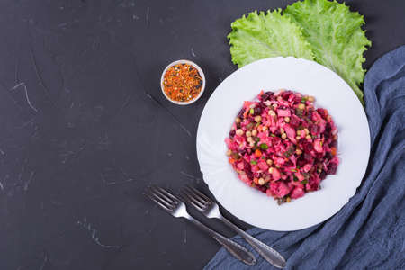 Traditional russian beetroot salad vinaigrette on white plate