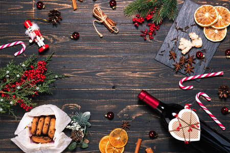 Photo for Bottle and glasses of red wine, Christmas ornaments - Royalty Free Image