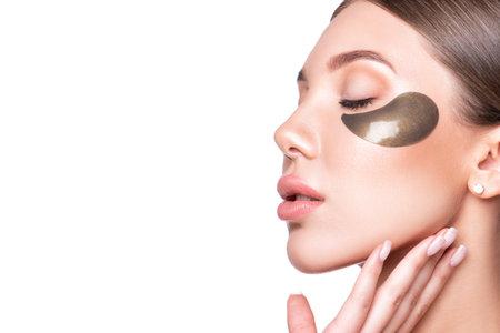 Foto de Beautiful model woman with collagen and hydrogel eye patch. - Imagen libre de derechos