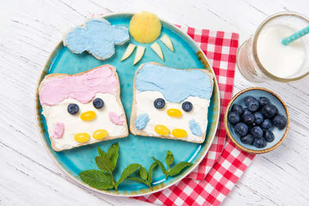 Photo pour Cute penguin toasts with spread on a plate, food for kids ideas, top view - image libre de droit
