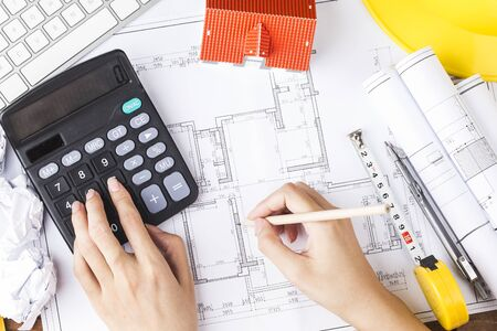 Photo for Hand drawing plan on blueprint with architect accessories. The concept of architecture - Royalty Free Image