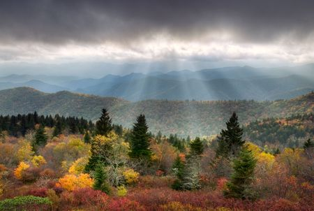Blue Ridge Parkway Scenic Autumn Landscape with sunbeams over mountains w/ fall foliage