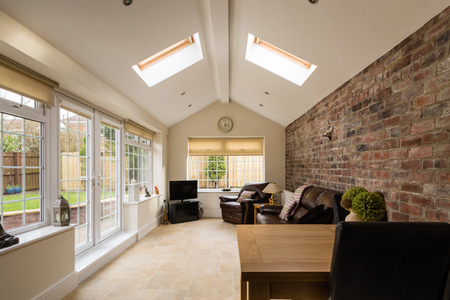 Sun Room / Modern Sunroom or conservatory extending into the garden with a featured brick wall