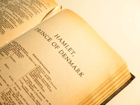 an old copy of the complete works of shakespeare open at the first page of Hamlet  Focus on the title   yellow ageing of page edges clearly visible