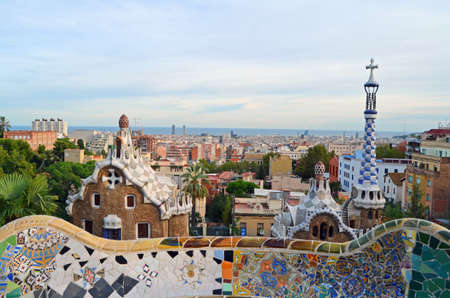 View of the pavilions of the entrance to Parc Guell with undulating bench