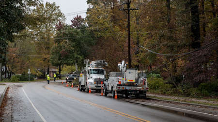 Photo pour Carrboro, North Carolina, US-November 13, 2018: Workers repairing power lines after tree fell on them in storm - image libre de droit