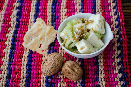 a fresh salad  with celery, nuts and cheese