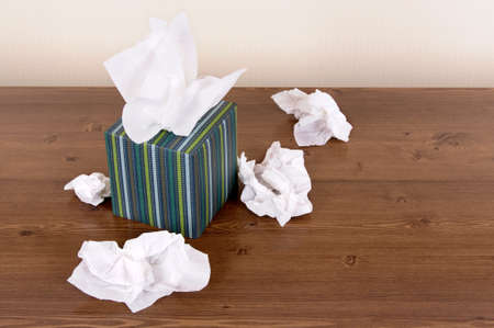 Box of tissue style tissues on a wood table.