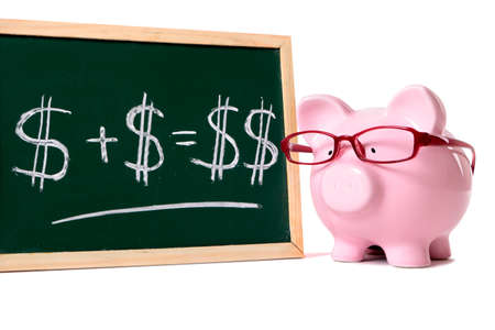 Photo pour Pink piggy bank with glasses standing next to a blackboard with simple money math isolated on a white background. - image libre de droit