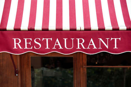 Foto de Striped french restaurant canopy in Paris france. - Imagen libre de derechos