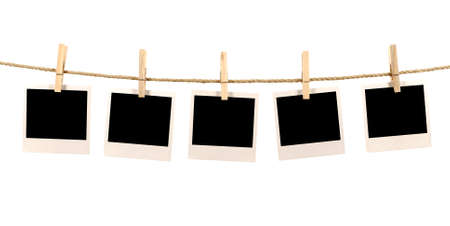Photo for Several blank polaroid style instant photo print frames hanging on a rope or washing line, white background - Royalty Free Image