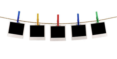 Foto de Several blank polaroid style instant photo print frames hanging on a rope or washing line, white background - Imagen libre de derechos