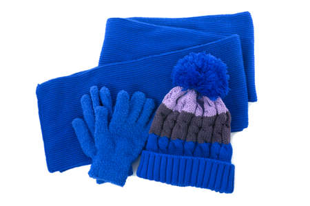 Photo pour Blue winter knitted bobble hat, scarf gloves isolated - image libre de droit