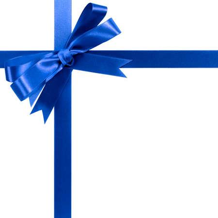 Photo pour Royal blue gift ribbon bow horizontal corner border isolated on white. - image libre de droit