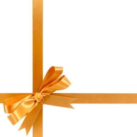 Photo pour Gold gift ribbon bow horizontal bottom corner cross shape isolated on white. - image libre de droit