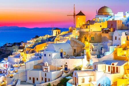 Photo for Sunset in Oia, Santorini island, Greece at sunset. Traditional and famous white houses and churches  with blue domes over the Caldera, Aegean sea. - Royalty Free Image