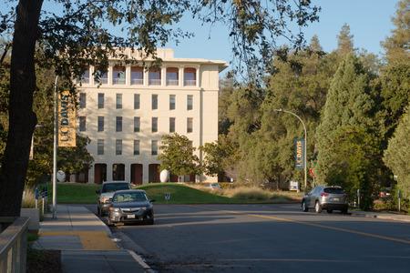 DAVIS CALIFORNIA, NOVEMBER 23 2016,  Looking down the street looking towards Mrak Hall, framed by trees, on the University of California, Davis campus.