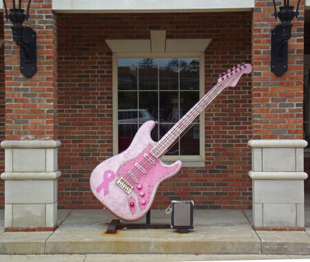Giant pink electric guitar located in Hudson Ohio