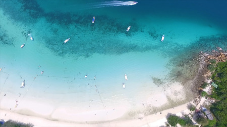 Aerial drone photo of iconic tropical turquoise water Pileh Lagoon surrounded by limestone cliffs, Phi phi islands, Thailand. Ao Pi Leh Lagoon at Phi Phi Islands in Andaman Sea ,Krabi, Thailand. Beautiful sea and blue sky at Similan island,Thailand. The l