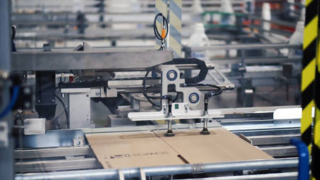 Cardboard package box packing machine. Clip. Box forming production line.