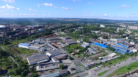 Foto de View from air on industrial zone in urban environment. Footage. Panorama from above offers view of industrial zone in city and stretches to horizon on clear day with blue sky. Industrial concept - Imagen libre de derechos