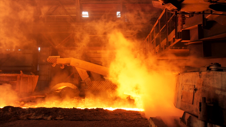 Foto für Hot steel being poured to the chute at the steel plant, heavy industry concept. Stock footage. Molten steel production in electric furnaces. - Lizenzfreies Bild