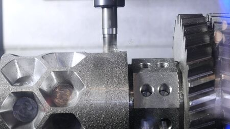 Photo for Metalworking cutting process by milling cutter. Media. CNC machine processes metal detail. Close-up of the metal workpiece processing on the latest machine - Royalty Free Image