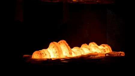 Photo pour Steel quenching at high temperature in industrial furnace at the workshop of a forge plant. Process of cooling, heat treatmen, blacksmith and metallurgical industry, steelmaking. - image libre de droit