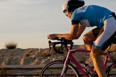 Photo pour Male triathlete in long distance competition. - image libre de droit